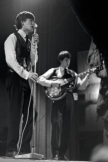 Keith Richards with his Harmony Rocket on stage with Mick Jagger in 1964