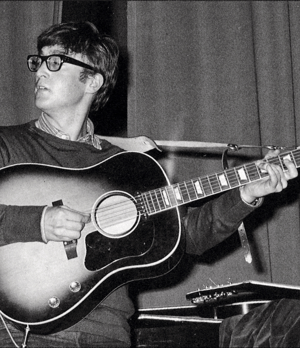 John Lennon with his 1962 Gibson J-160E and Selmer strap.