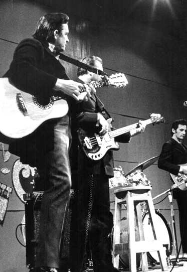 Marshall Grant with his Newport Bass on stage at San Quentin with Johnny Cash.