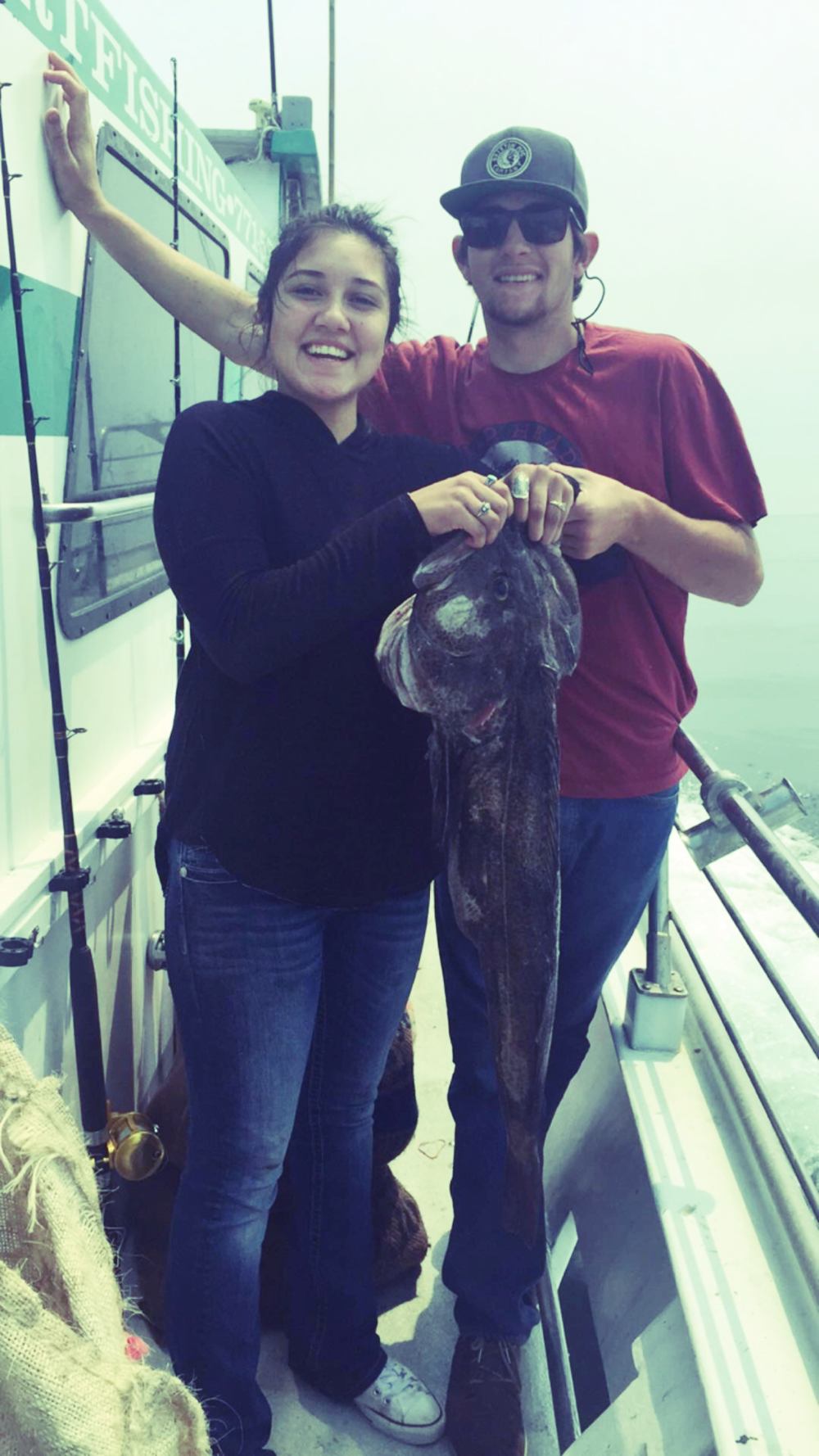 Emily and Zeb with her 18 lb. Lingcod