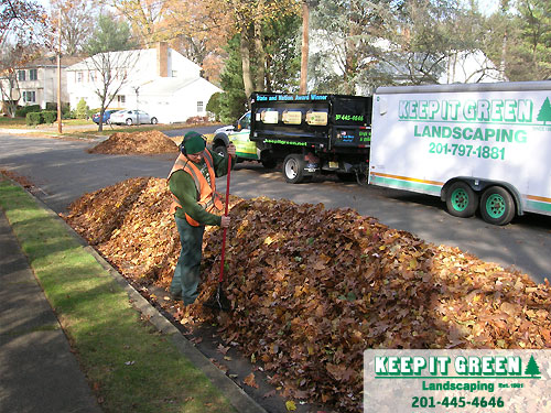 Landscape technician creates path for water flow. Paramus, NJ 07652