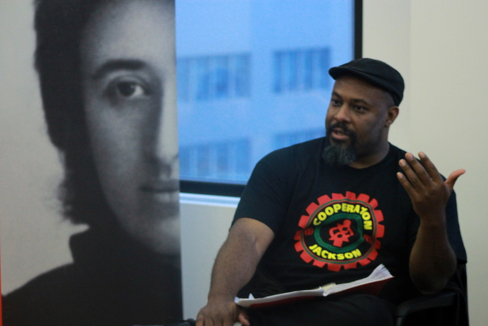 Kali Akuno, who was late Jackson Mayor Chokwe Lumumba's coordinator of special projects, describing the Jackson Rising conference at the Rosa Luxemburg Foundation office in NYC on June 3. Credit: Rosa Luxemburg-NYC/Flickr