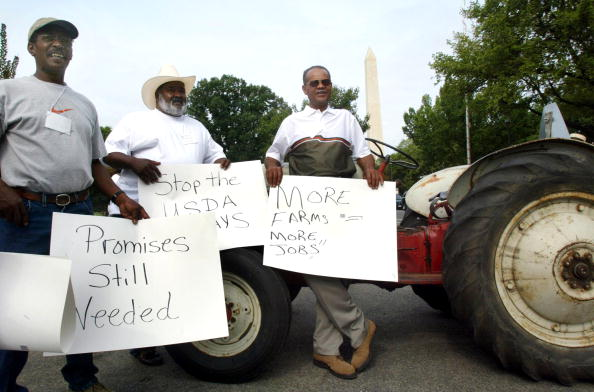 FARMERS WITH THE NATIONAL BLACK FARMERS ASSOCIATION PROTEST IN FRONT OF THE DEPARTMENT OF AGRICULTURE IN WASHINGTON, DC.