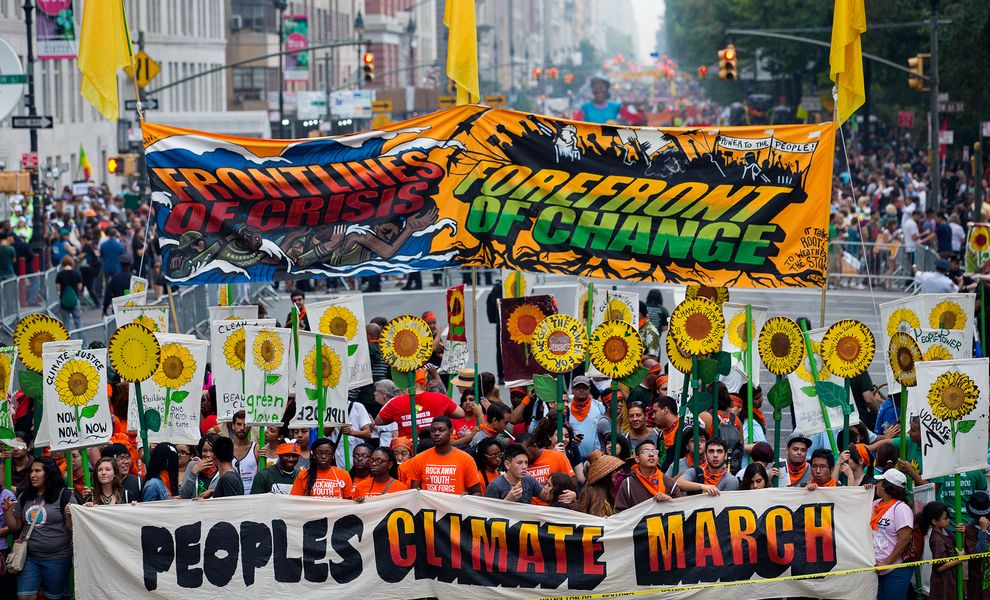 PARTICIPANTS GATHER NEAR COLUMBUS CIRCLE IN NEW YORK CITY FOR THE PEOPLE'S CLIMATE MARCH ON SUNDAY. PHOTOGRAPH BY CRAIG RUTTLE, AP
