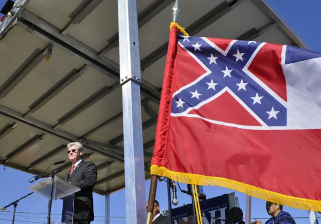 Mississippi Governor Phil Bryant declaring April 2016 Confederate History Month at the opening of the new Civil Rights Museum on Wednesday, February 24, 2014, i.e. Black History Month.
