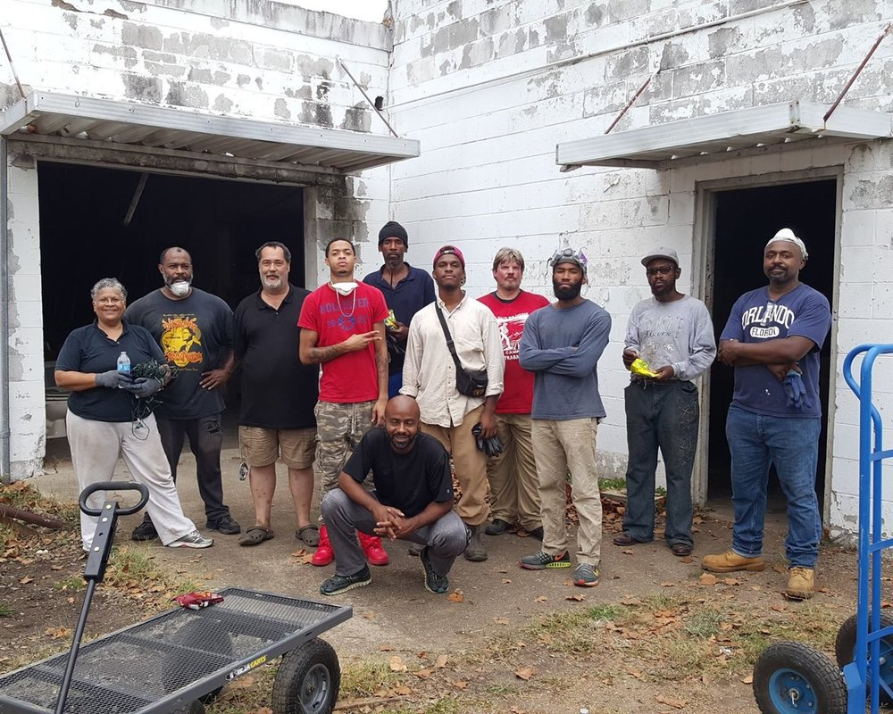 PHOTO OF COOPERATION JACKSON MEMBERS CLEANING OUT COMMUNITY PRODUCTION CENTER THIS PAST FALL