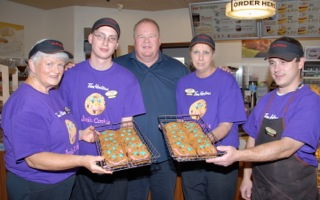 Shown with samples of this year's cookies are, from left, Grace Drummond, Tyler Dion, Almonte Tim Hortons owner Brian Quarrington, Joanne Tysick and Tom Stanley.