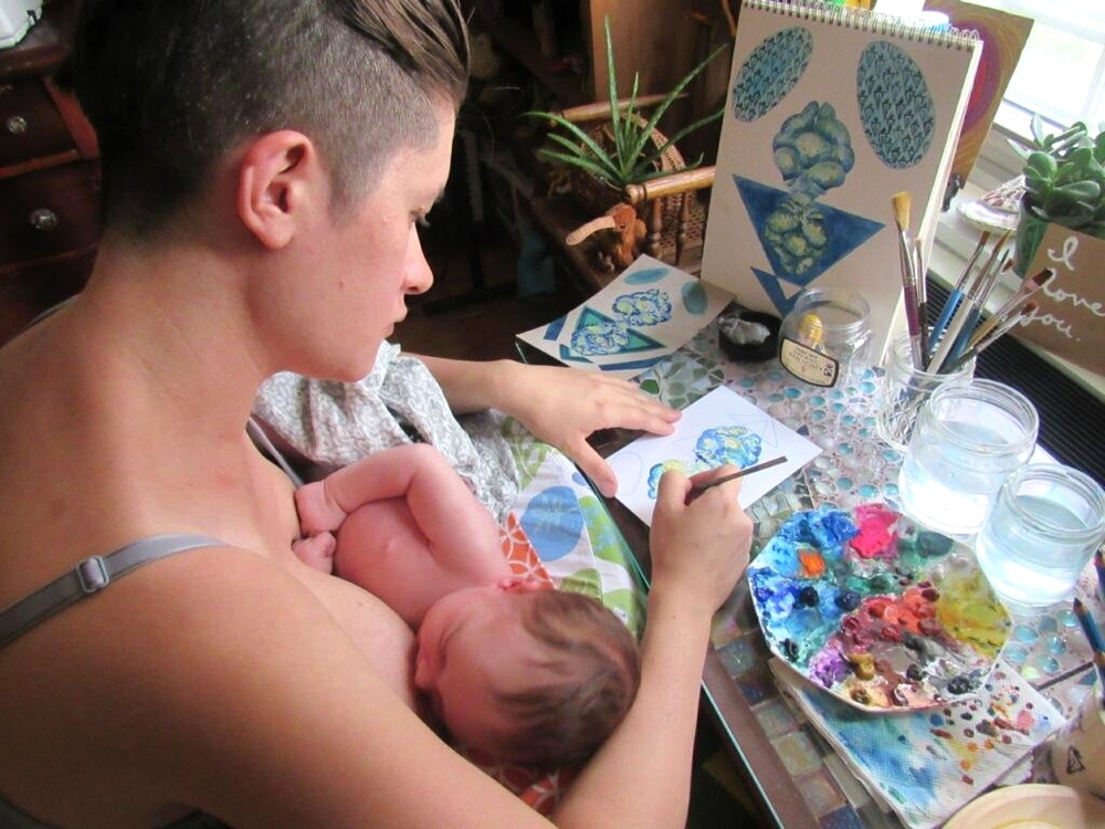 What I do when I'm not watching movies, writing blog posts, wasting away on Facebook, eating or sleeping: breastfeeding + painting. Photo by Danny Valdes.