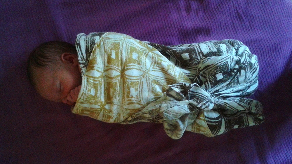 All wrapped up in Grammy's blanket:  Baby Vee at one week, 8/6/15 at 6:30am