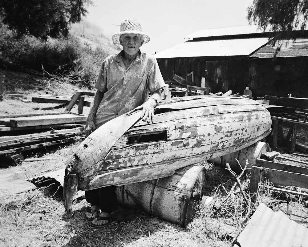 Whitey Harrison, with an old outrigger canoe at the family house in San Juan Capistrano, circa 1980. Craig Stecyk