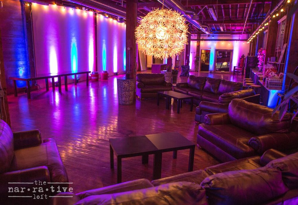 Colorful lights and cushy couches for the guests.