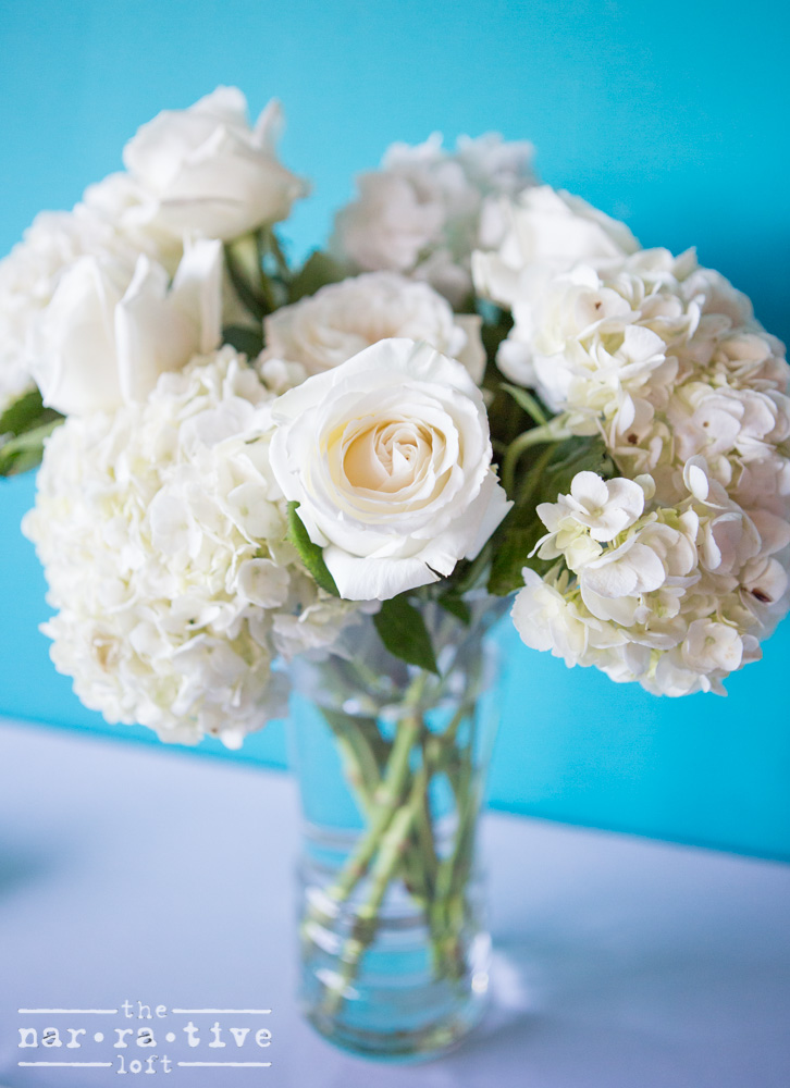 White roses, tulips and hydrangeas scattered the loft.