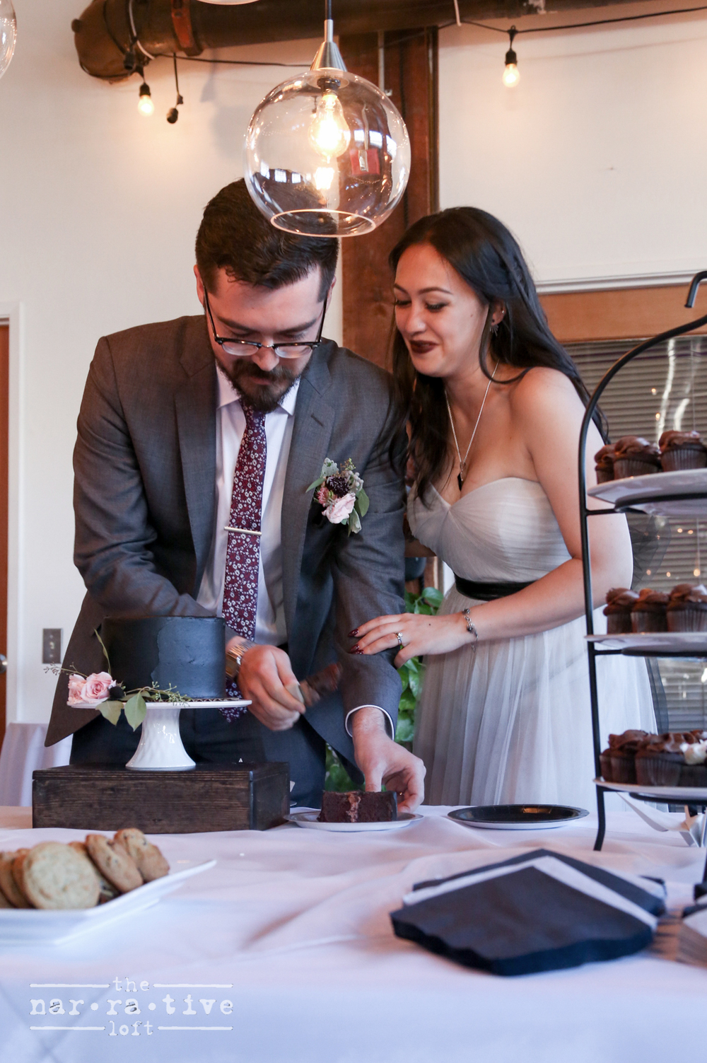 A sweet moment between Ken and Ashley cutting the cake.