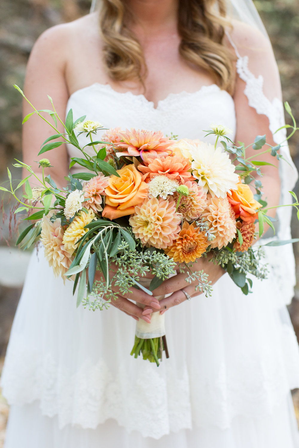 Becky Davis Photography  Megan stands with her stunning fall bouquet full of heavenly Dahlias.