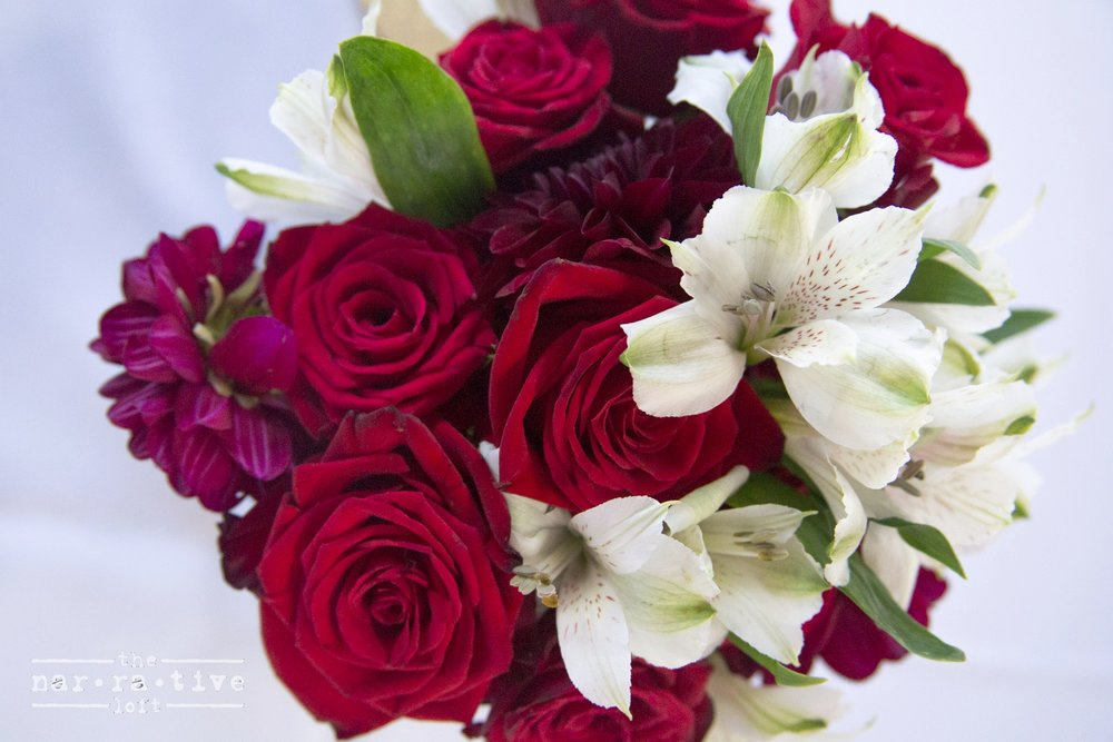 Red roses made the bouquets from A Smiling Garden pop with color.