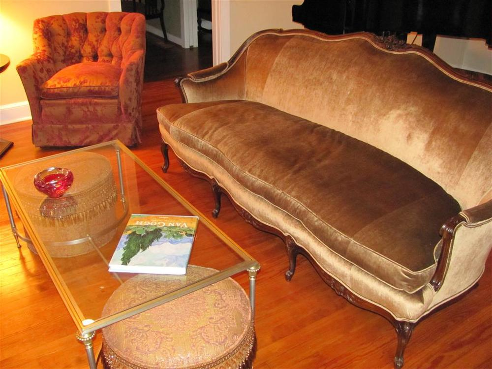 Sofa covered in up-the-roll velvet - seamed to cover the widths.