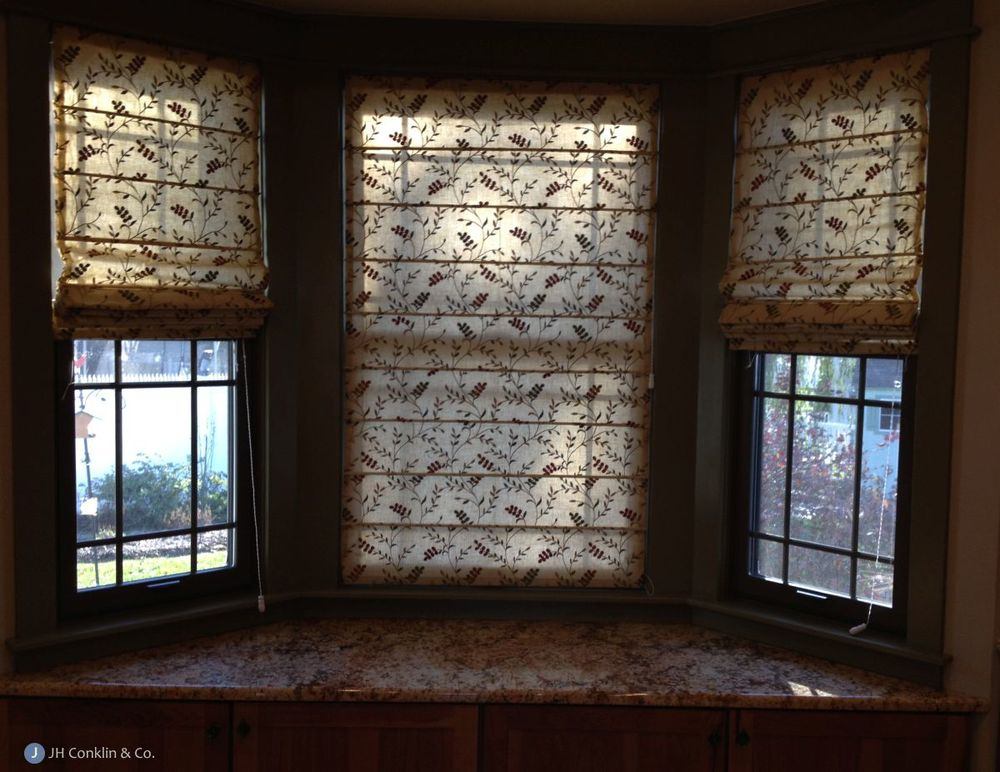 Vines and lines using fabric in design for Roman shades for bay windows
