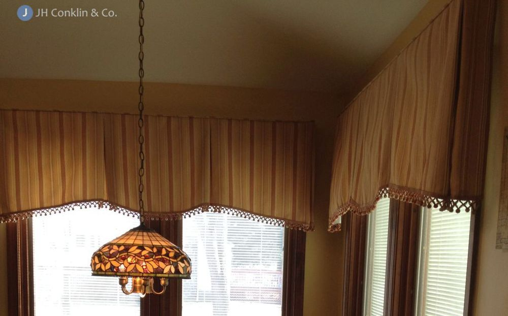 Valances color matched with the benches and light shade in this Gloucester County NJ kitchen.