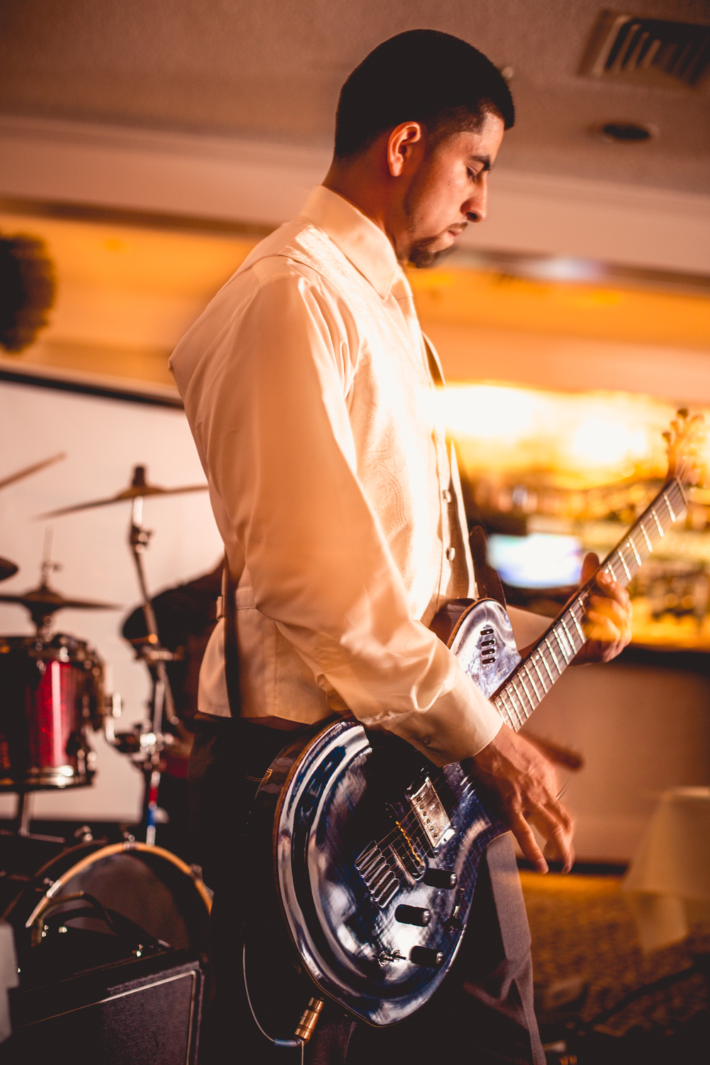 Alex and his band  performing at his own wedding.