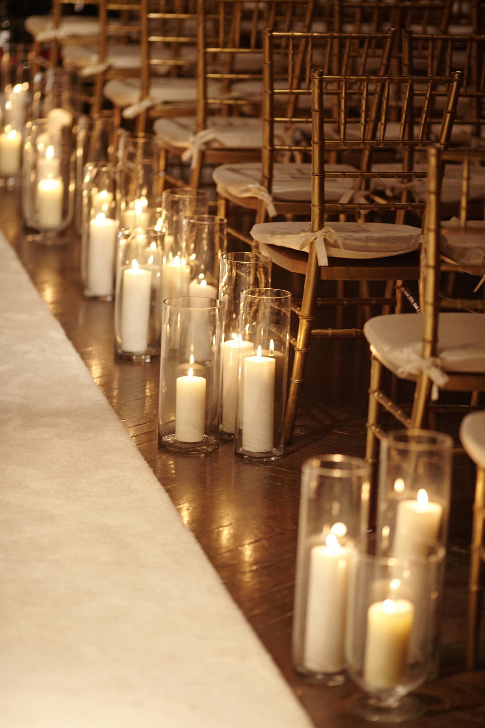 Hurricane candles wedding aisle