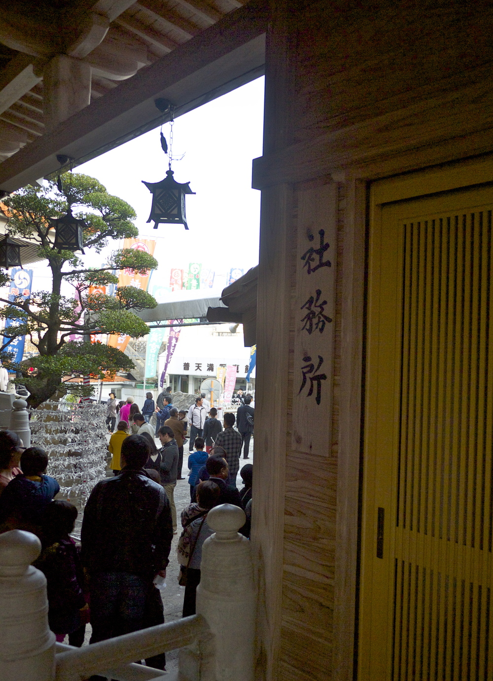 Wooden traditional Japanese architecture and hanging lanterns at the shrine