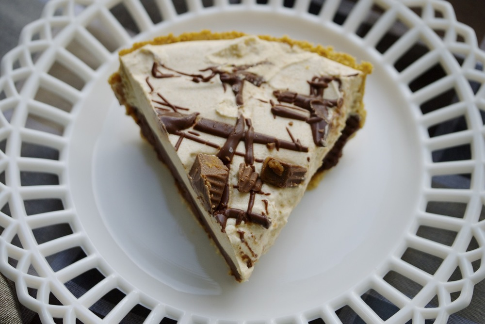 piece of chocolate peanut butter cup pie with graham cracker crust
