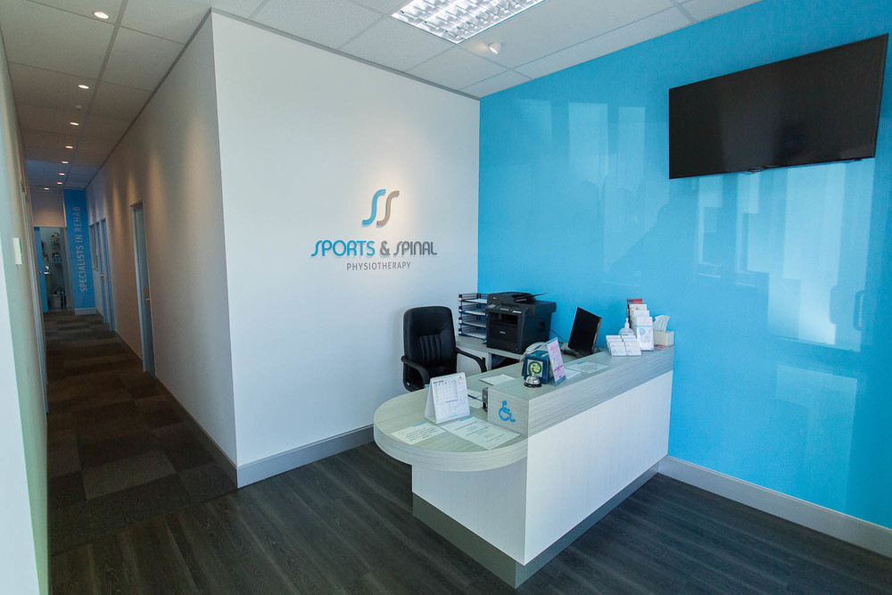 Sports and Spinal reception area, brand/logo on wall - Lloyd Sinton Design - interior/exterior design – space-planning – shop-fitting – fit out – signage