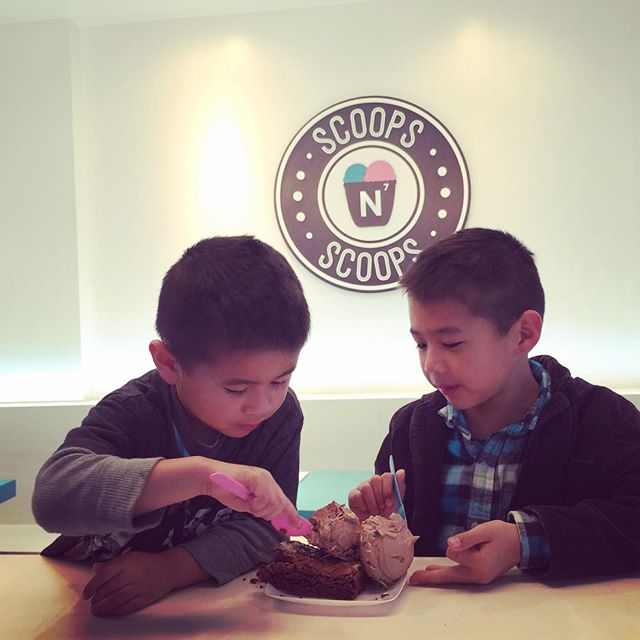 Brotherly love sharing an ice team brownie.