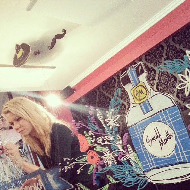 Artist, Michaela Gibiecová from MGDA, working her magic on a mirror painting appropriating Small Mouth branding.