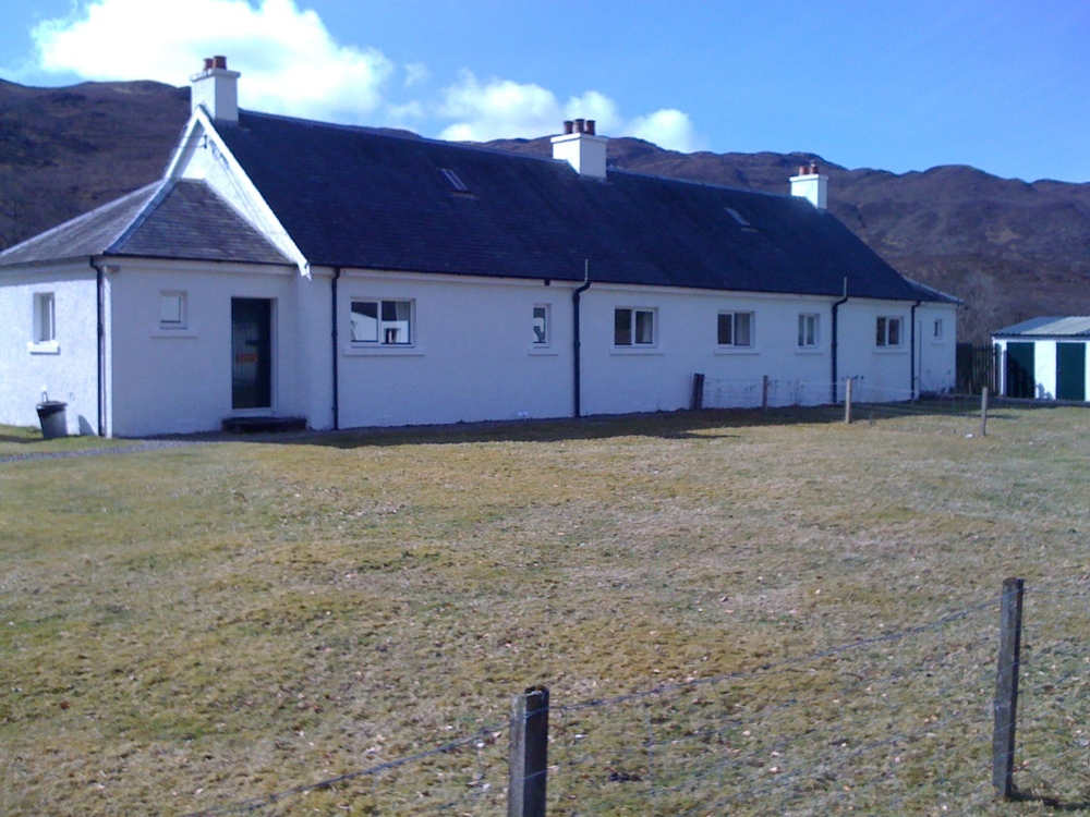 Strathan Cottage on left