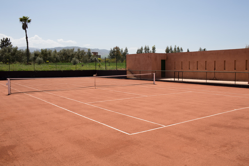 Tennis court     - clay court with club house and shower