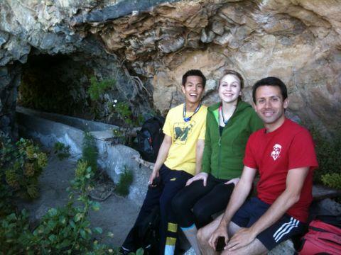 Telluriders climbing through caves