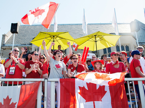 Canadian fans with painted faces celebrate in the crowd as they watch the 2015 Para Pan Ams