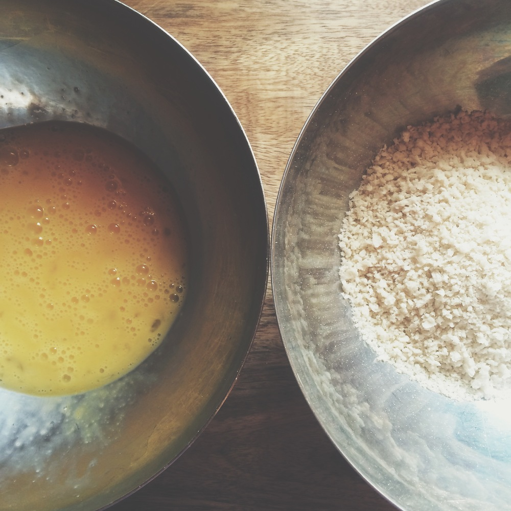 Two bowls: One with whisked eggs. The other, Panko.