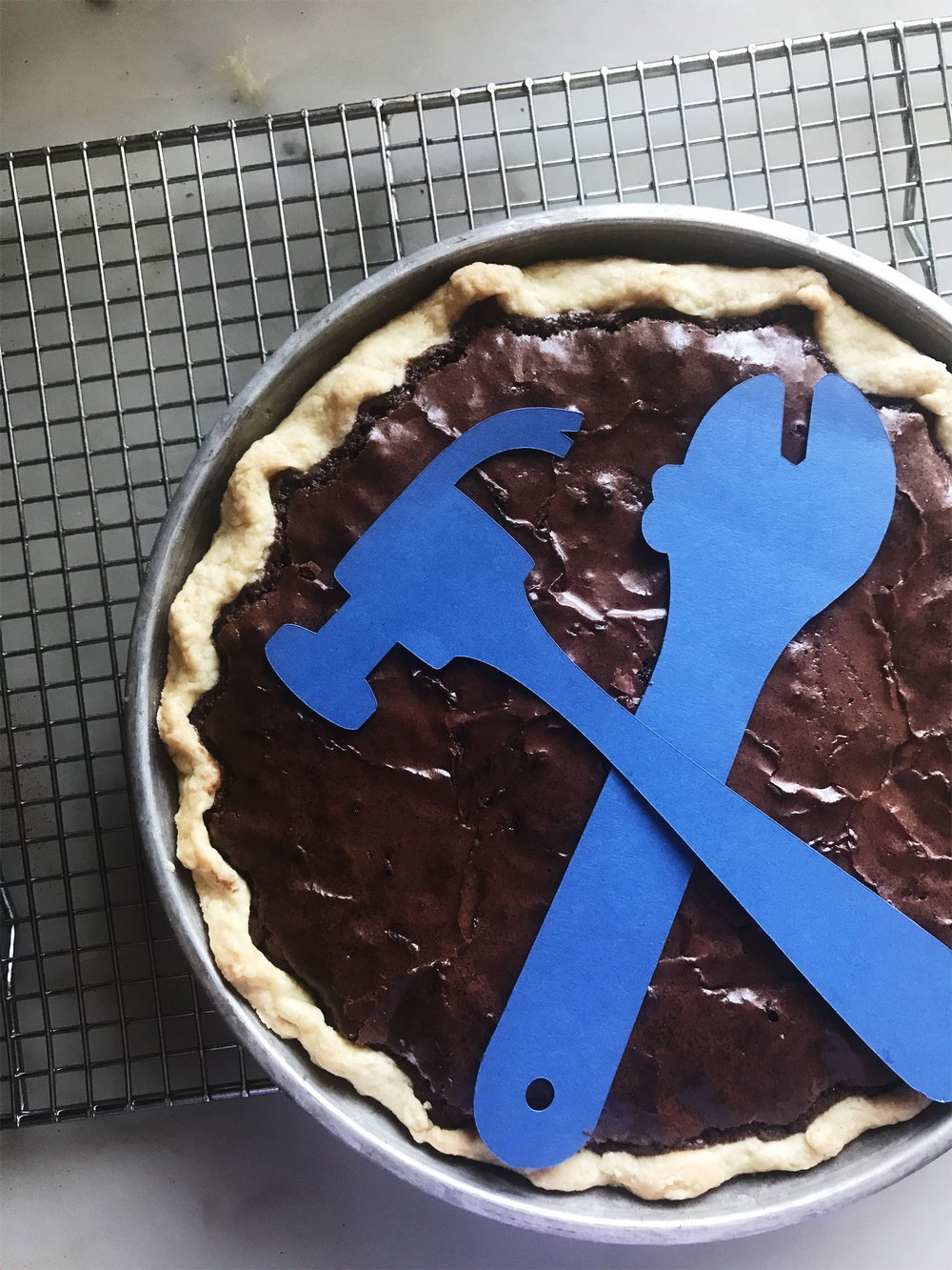To assemble a brownie pie, line a 9 inch tin with your favorite crust. I use this one from Williams Sonoma. Fill with brownie batter and bake in a 350 degree pre-heated oven for 50 minutes. I used my Cricut Explore Air 2 to make Labor Day themed stencils. Top with powdered sugar, and serve.