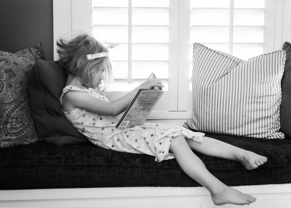 mary reading in windowsill.jpg