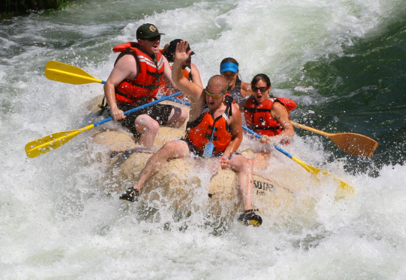 """Tumbleweed"" soaks Jeremiah as he rides the bull through one of the wettest, wildest rapids on the river!"