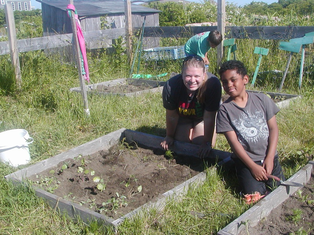 One of the students and I at the community garden planting.