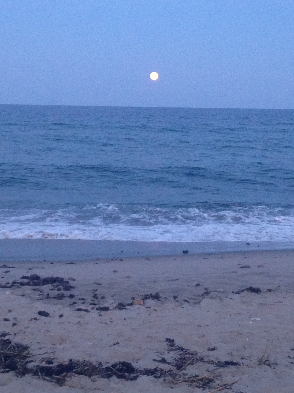 Moonrise looking onto ocean at end of Clay Head trail.