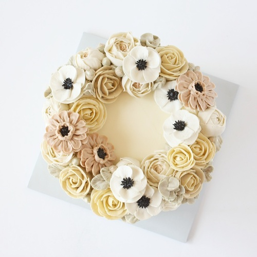 Buttercream rose peony ranunculus flower cake