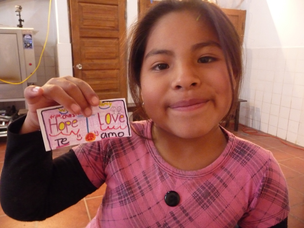 A child in Peru receiving a sticker brought over from a child in the U.S.