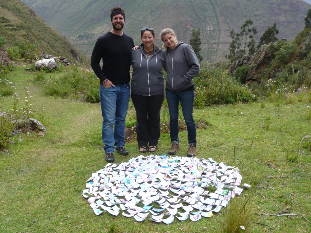 Austin, Alejandra, and Rhea in Peru preparing to deliver stickers.