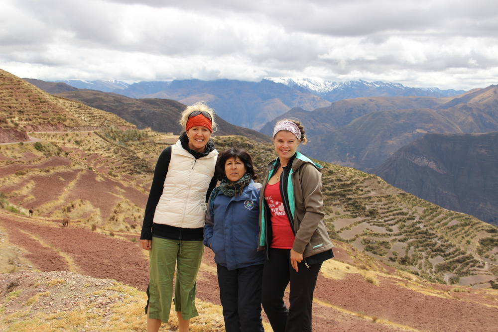 Too amazing not to ask the driver to stop for a photo.  This was the highest I have ever travelled, after a drive that had me praying!  Still, I had to ask for a pause to get a photo with the team for the day, Erica Peabody, Miriam, and Me, with the fresh dusted snowy peaks in the background.