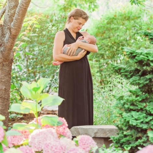Dr. Rhea Zimmerman Komarek with her newborn Destry.