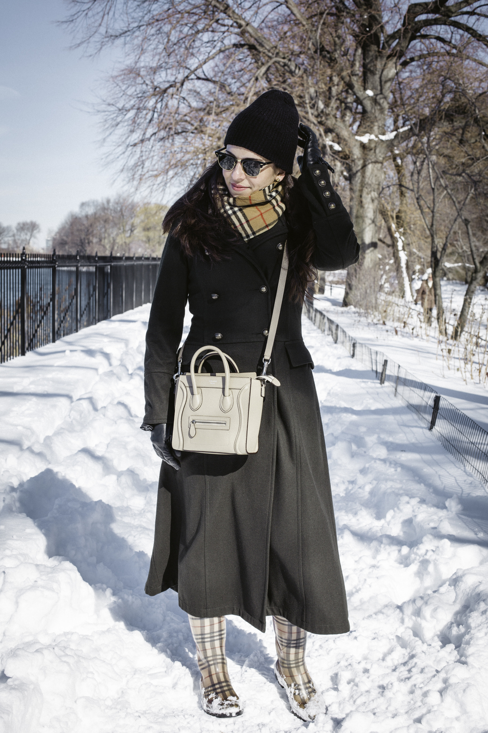 Walking Central Park in my  Burberry  rain boots and matching scarf,  Celine  Nano Crossbody bag,  Zara  military pea coat,  Urban Outfitters  beanie and  Ray Ban  sunglasses.  Photography by  Francisco Graciano .