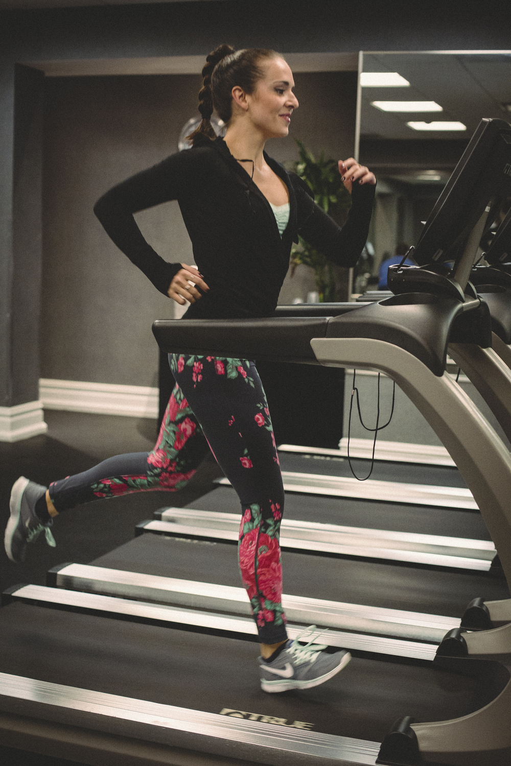 In my Athleta hoodie and Albion fit floral workout leggings and Nikes at the gym. Photography by Francisco Graciano.