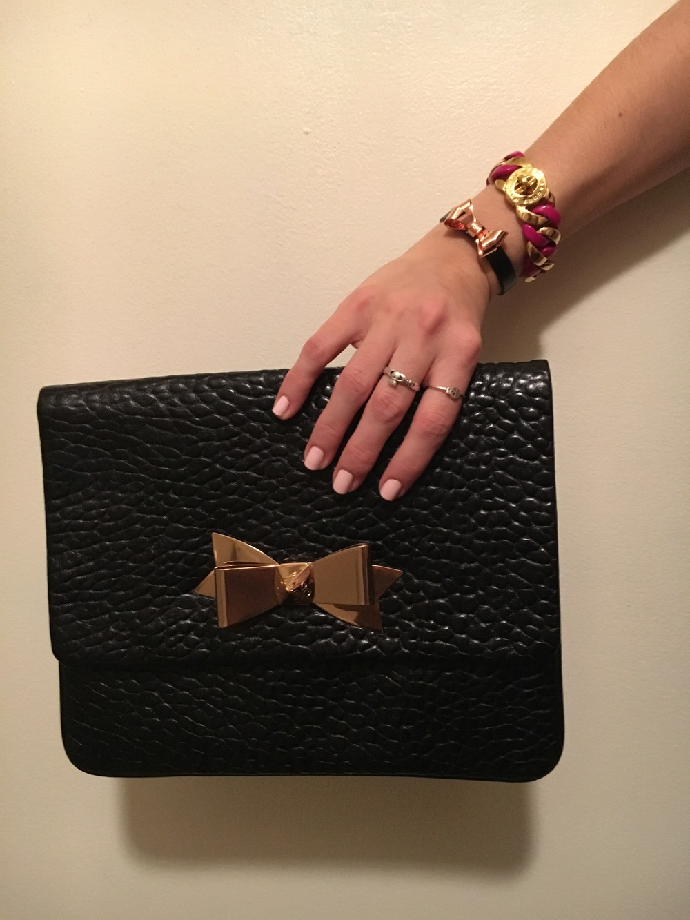 Ted Baker  clutch and bow bracelet,  Marc by Marc Jacobs  link bracelet.