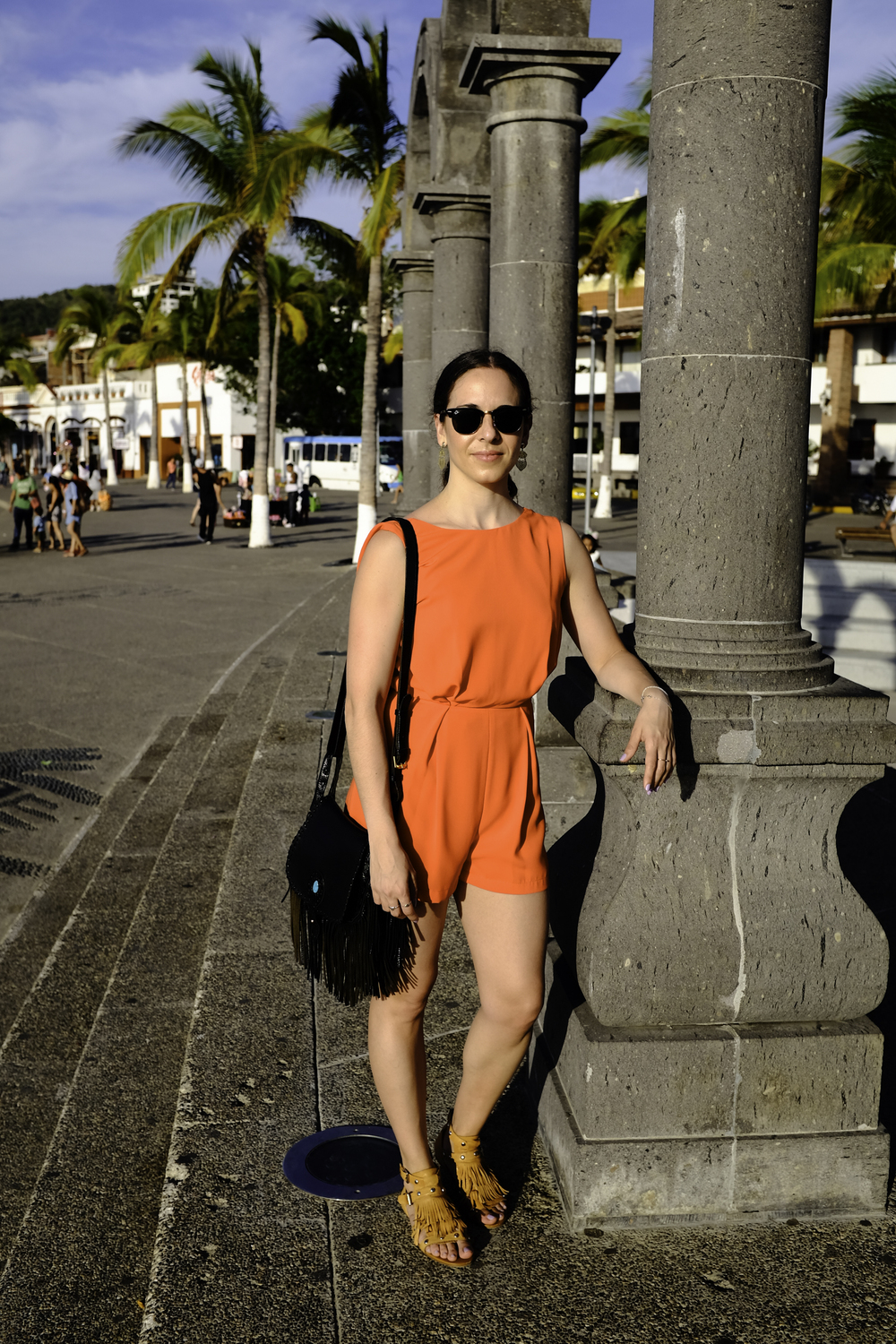 In my orange and black lace  T  opshop  romper, tan fringe sandals from Spain and black cross body fringe  Rebecca Minkoff  purse in Puerto Vallarta, Mexico.  Photography by  Francisco Graciano .