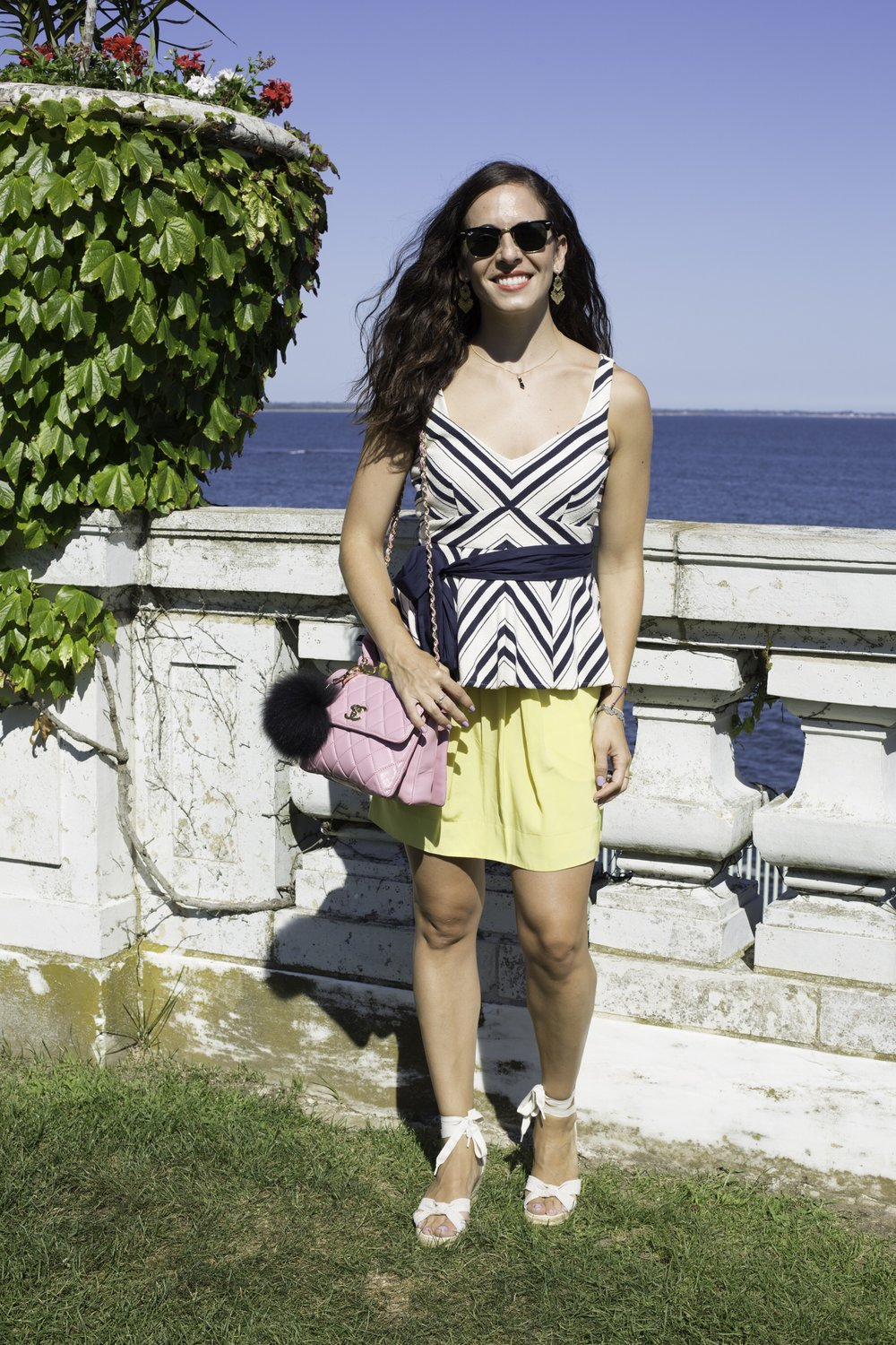 Wearing an Anthropologie nautical top with BCBG yellow skirt, JCrew espadrille wedge sandals, and a Chanel pink quilted purse. Photography by Francisco Graciano.