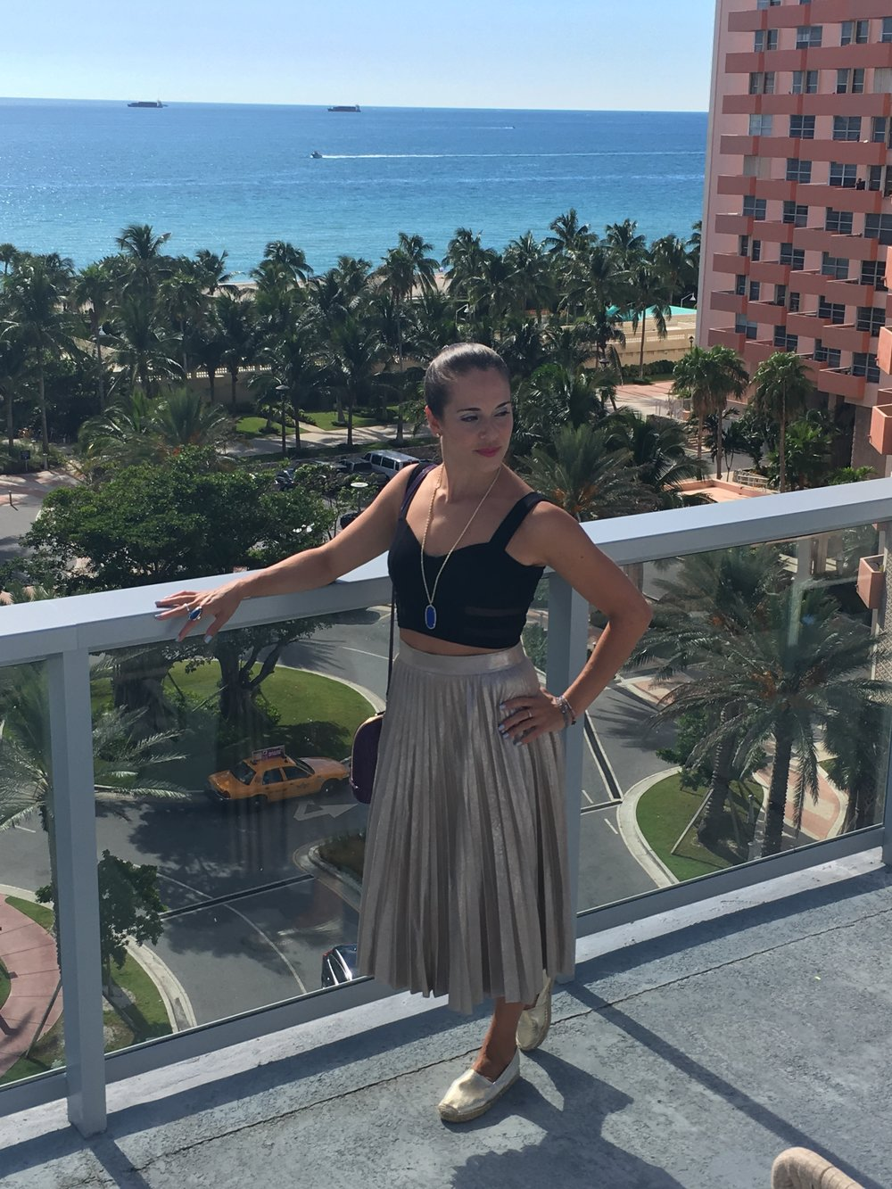In this look worn on a recent trip to Miami (look at that view!!) I styled the same  Zara  skirt with an older  H&M  crop top and my  Maypol  gold espadrille flats.